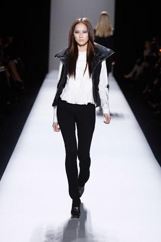 Nicole Miller adds a sporty zip front vest.