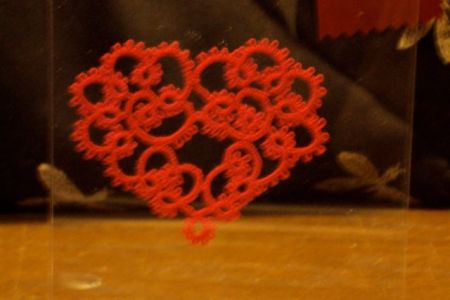 tiny, handcrafted red lace heart