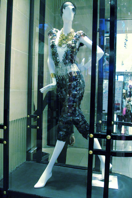 A mannequin dressed entirely in sunglasses.  Snapped last week at Henri Bendel, 5th Ave., NYC